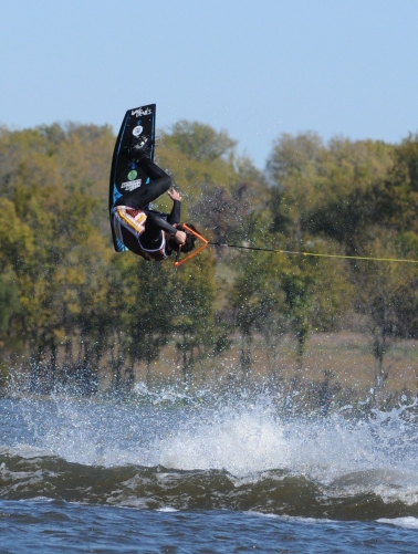 Tyler Martinez (Arizona State) reaching for an indy front roll.